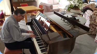 Roy Steen playing the Schimmel grand piano.