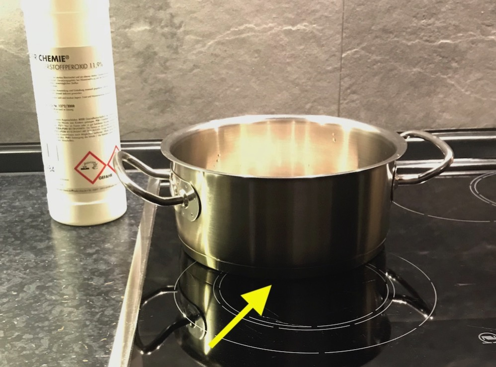 Pan on stove top, moved way off center for less heat exposure.