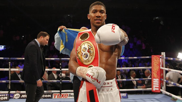 "Anthony Joshua Replies Fan Who Asked Him ""Wetin Dey For The Boys""… (Photos)"