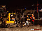 Forklift moving concrete block back into position
