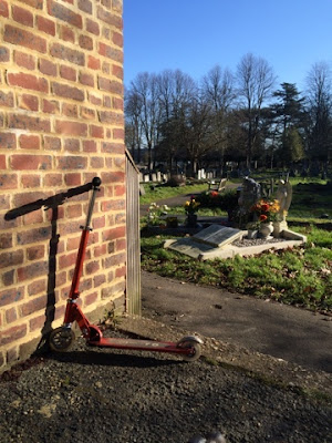 Autistic child scooter on school run through cemetery