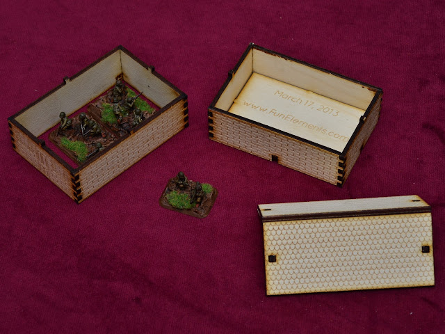 Demonstration on how to use the laser cut house, with two levels and space for two bases (four in total).