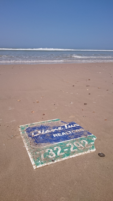 A realtor's sign from a house in New Jersey was washed away by Hurricane Sandy and appeared on a beach in France, around 14 May 2018. Photo: Hannes Frank / The New York Times