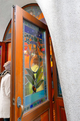 Ghibli Museum - Stained Glass on the front doors which pay homage to My Neighbor Totoro - they had stained glass with Ghibli characters in many places including the skylight ceiling in the Central Hall