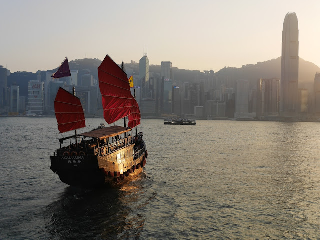 junk boat with red sails in Hong Kong's Victoria Harbour