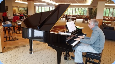 Claude Moffat playing the Kohler and Campbell grand piano.
