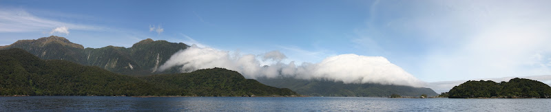 Cloud-covered mountains at the end of Doubtful Sound panorama