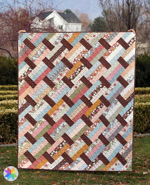 Fast Track quilt pattern in Folktale fabric - pattern by A Bright Corner and uses precut fabric like jelly rolls layer cakes or fat quarters