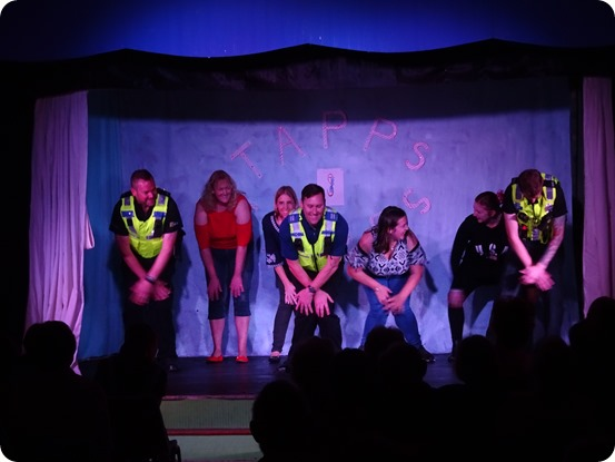 Crewe South police officers assist in performing Cha Cha Slide