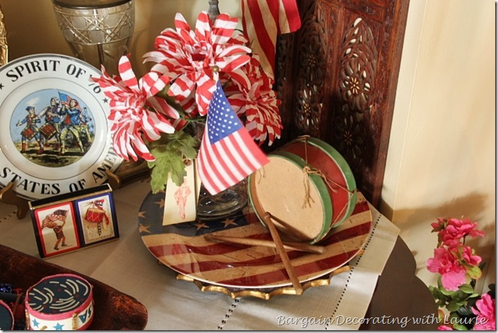 Flags flowers and vintage toy drum in 4th of July vignette