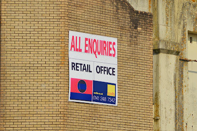 26-06-2013 - By Scott Campbell (+44) 0774 296 870 - Cumbernauld Town Centre; Picture shows 'All Enquiries' sign on Cumbernauld Town Centre, close-up, from Central Way.
