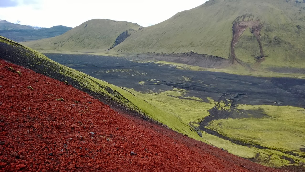 Standing on top of a huge scoria cone, landslide has created face of Jesus on hyaloclastite mountain. Somewhere in the highlands near Landmannalaugar. J-M Kekki