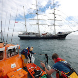 21 August 2011 - Training with the Jubilee Sailing Trust's ship Tenacious - getting ready to come alongside and pass over a stretcher with our casualty 'dummy' strapped inside. Photo: RNLI Poole/Dave Riley