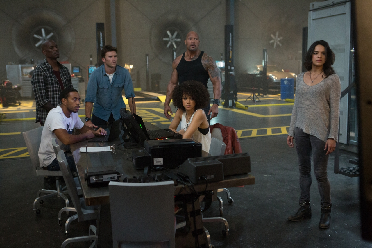 """(L to R) Chris """"Ludacris"""" Bridges, Tyrese Gibson, Scott Eastwood, Dwayne Johnson, Nathalie Emmanuel and Michelle Rodriguez in THE FATE OF THE FURIOUS. (Photo by Matt Kennedy / courtesy of Universal Pictures)."""