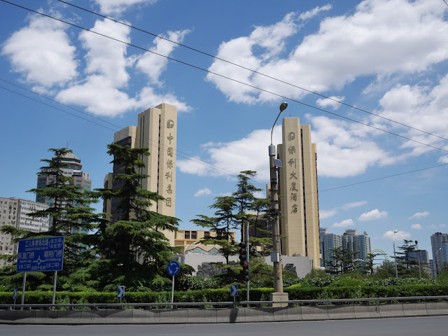 blue skies above the intersection at the Dongsi Shitiao metro station in Beijing