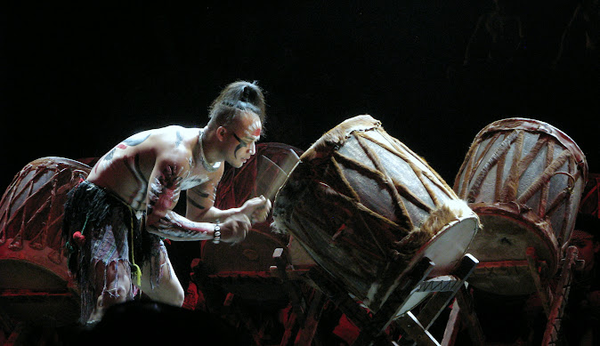 Drum solo by the Yi minority group at the Dynamic Yunnan show, Kunming, Yunnan