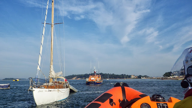 Poole ALB and ILB heading towards the entrance to Poole Harbour, while the yacht's crew and a crew member are checking all is okay on the yacht - 8 August 2013 Photo: RNLI/Poole