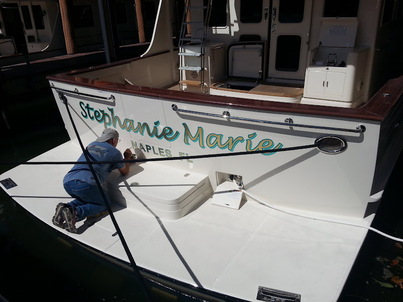 gold leaf boat lettering for Stephanie Marie