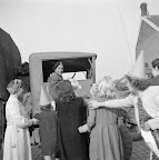 Women and children with orange party hats welcoming an allied truck driver. Date: September 18, 1944. Photographer: Willem van de Poll. Source: Dutch National Archive
