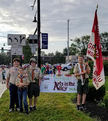 Boy Scout Troop 392 marching in the 2017 Arts in the Alley Parade