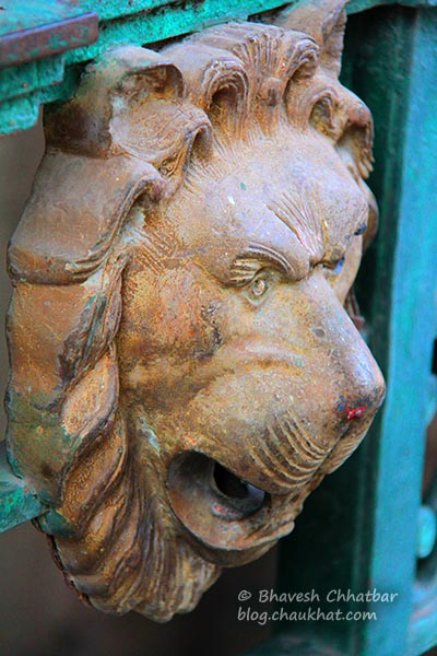 Lion face on the gates of Shinde Chhatri