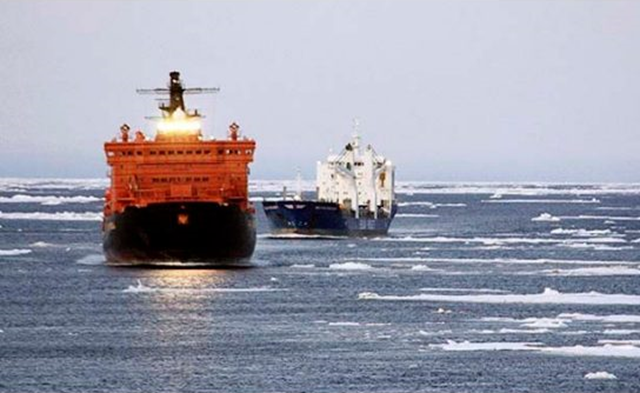A pair of German merchant ships are seen as they traverse the fabled Northeast Passage around Russia's Arctic coastline. Photo: Associated Press