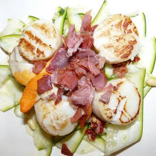 Scallops with Ham on Zucchini Carpaccio.