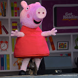 WWW.ENTSIMAGES.COM -      Peppa Pig reading at   Get Reading festival at Trafalgar Square, London Organised by the Evening Standard in partnership with e-reader firm NOOK July 13th 2013                                             Photo Mobis Photos/OIC 0203 174 1069