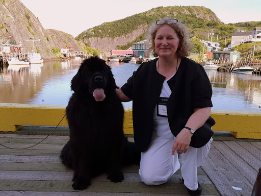 With a Newfoundland dog at Quidi Vidi, St. John's, Newfoundland