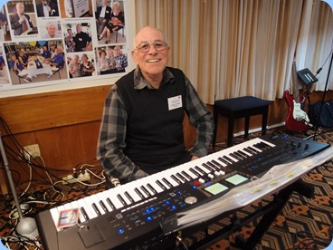 The Club Treasurer, Laurie Conder, playing the arrival music on his Roland BK-9. Laurie also gave a mini-concert for us in the first half. Photo courtesy of Dennis Lyons.