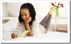 stock-footage-happy-black-woman-writing-in-journal