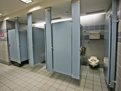 "**CORRECTS DATE TO SEPT. 17 ** The stalls in the men's room at the Minneapolis St. Paul International Airport where U.S. Sen. Larry Craig, R-Idaho, was arrested June 11 by a Minneapolis airport police officer., are shown Monday Sept. 17, 2007. The Idaho Republican pleaded guilty to misdemeanor disorderly conduct. Craig has since said his guilty plea was a mistake.  ""It's become a tourist attraction,"" said Karen Evans, information specialist at the Minneapolis-St. Paul International Airport. ""People are taking pictures.""  AP Photo/Andy King)"