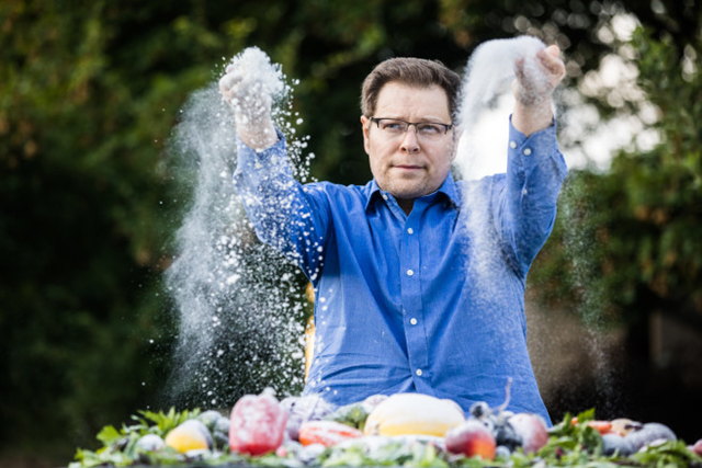 Mathematician Irakli Loladze tosses sugar over vegetables outside his home in Lincoln Nebraska, to illustrate how the sugar content of the plants we eat is increasing as a result of rising carbon dioxide levels. Loladze was the first scientist to publish research connecting rising CO2 and changes in plant quality to human nutrition. Photo: Geoff Johnson / POLITICO