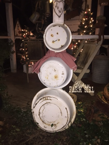 Enamel pans used to create a snowman