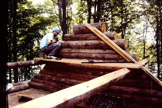 Photo: Dan setting up to cut gable logs at an angle.
