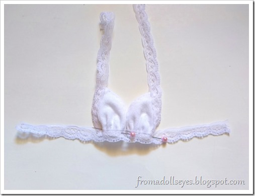 Making bras for bjds.  Pin the triangle pieces to this lace and try on the doll for fit. Then sew.
