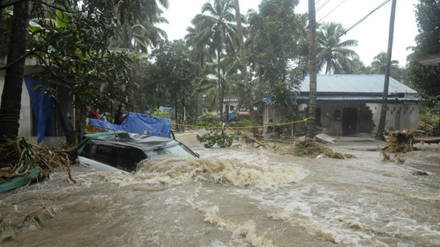 A car is submerged as roads and houses are engulfed in water following heavy rain and landslide in Kozhikode, India, 10 August 2018. Photo: AP Photo
