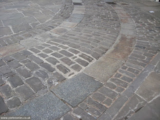 Pleasing curve of cart tracks and setts curving towards Colliergate, King's Square, April 2013