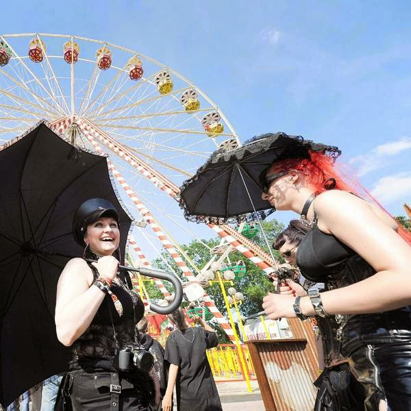 Heavy metal fans pose for a photograph during the Hellfest Heavy Music Festival on June 20, 2014 in Clisson, western France.