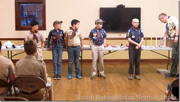 Peter bridging up to boy scouts at Homeschooling Hearts & Minds