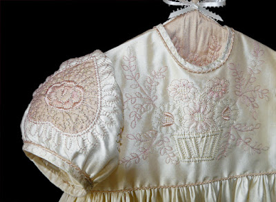 Hand-quilted silk christening gown.