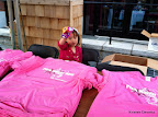 """Niblette helping hand out shirts to our """"Pink Honor Roll"""" (aka the top 100 fundraisers) before the race."""
