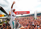 Lewis Hamilton climbing fence