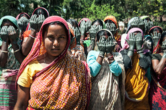 Photo: Nimai Chandra Ghosh, an India-based photographer, submitted this photo in the 11th Annual Photoshare Photo Contest. The Photoshare Contest Winner image shows a woman in protest with others in India against rape backlash.