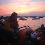 Dave Riley onboard the ILB with Glen Mallen alongside, while crew, Coastguard and paramedics treat a disorientated kayaker - 21 September 2014.  Photo credit: Mark Thompson
