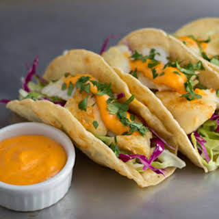 Fish Tacos with Cabbage Slaw and Spicy Sriracha Sauce.