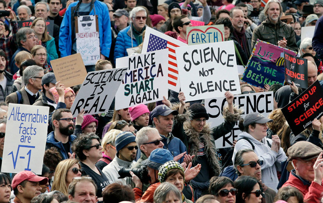 Members of the scientific community, environmental advocates, and supporters demonstrate on Sunday, 19 February 2017, in Boston, to call attention to what they say are the increasing threats to science and scientific research under the administration of President Trump. Signs bear slogans like, 'Make America Smart Again' and 'Science Not Silence'. Photo: Steven Senne / AP Photo