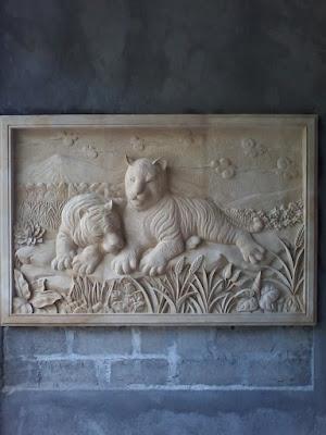 relief batu alam paras jogja motif sepasang harimau
