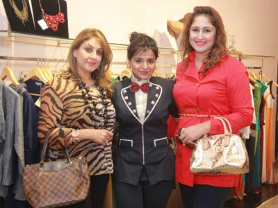 Meenaxi Dutt, Kanika Jain and Manya Bhasin pose for the shutterbugs during Kanika Jain's new collection launch at 114 Shahpur Jat, Delhi.