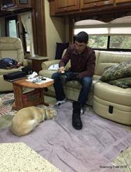 Polishing his boots